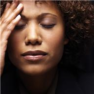 woman - hand on forehead - pain